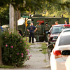 Officials with Floyd County Metro SWAT and the New Albany police and fire departments work the scene of a domestic dispute that was treated as a possible hostage situation along the 1100 block of Greenaway Place in New Albany on Friday morning. No one was injured during the incident. Staff photo by Christopher Fryer