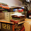 Public records sit stacked among other various items across from sliding shelves packed full of other records inside the Court Storage Room in the basement of the Clark County Government Building in Jeffersonville on Thursday. Officials are working on a plan to improve storage and security for the legal documents. Staff photo by Christopher Fryer