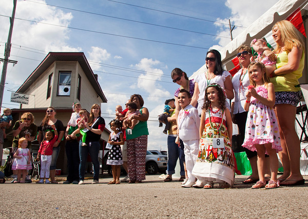 Participants pose for photographs and wait to hear the results of the beautiful bambino contest during the fourth annual Jeffersonville Italian Festival on Saturday afternoon. Staff photo by Christopher Fryer