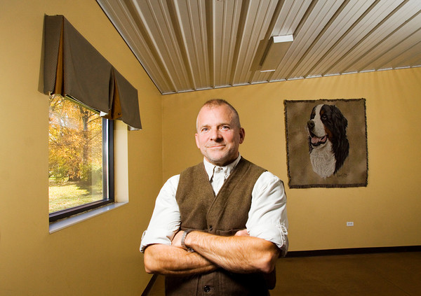 "Dog trainer Matthew Duffy, 56, stands inside his business, Duffy's Dog Training Center in Jeffersonville. Duffy recently wrote ""Dog Training and Eight Faces of Aggressive Behavior: A Master's Solution to Barkers, Growlers and Biters"" which is scheduled to be released in early December. Staff photo by Christopher Fryer"