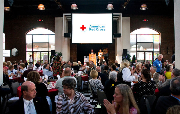 "Guests eat dinner during the annual Bales' Humanitarian Gala at Kye's in Jeffersonville on Thursday evening. Charles ""Chuck"" Ledbetter Sr. and Richard ""Dick"" Jones were recognized as humanitarian honorees at the Clark County American Red Cross fundraiser. Staff photo by Christopher Fryer"