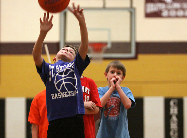 Nolan Flispart puts up a shot in the Optimist Club of Clarksville annual Tri-Star pass, dribble and shoot basketball competition Tuesday night. Boys and girls 8-13 competed with the winner in each age division advancing to a regional competition in Huntingburg, Ind. Staff photo by C.E. Branham