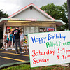 Customers stand in line to get ice cream and other treats during the 60th anniversary celebrations at Polly's Freeze on Saturday afternoon in Georgetown. Staff photo by Christopher Fryer