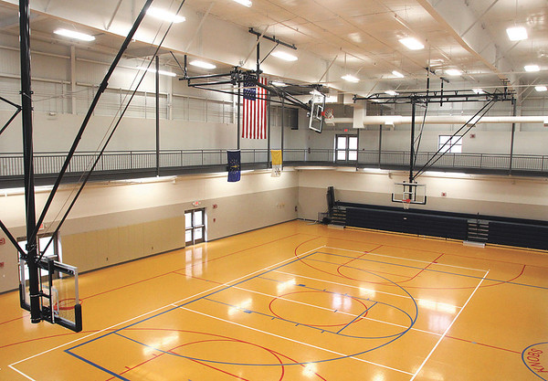 The Geis Activities Center, connected to the new St. Mary of The Knobs Catholic church by a commons area, has two full courts, conference rooms, walking track, and commercial kitchen.  Staff photo by C.E. Branham