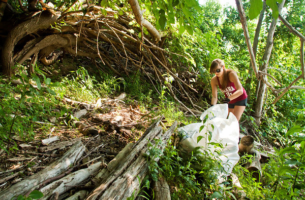 Rachel Jacobi, of Floyds Knobs, fills plastic bags with garbage and debris she and other volunteers collected during the 2013 Ohio River Sweep in New Albany on Saturday morning. Staff photo by Christopher Fryer
