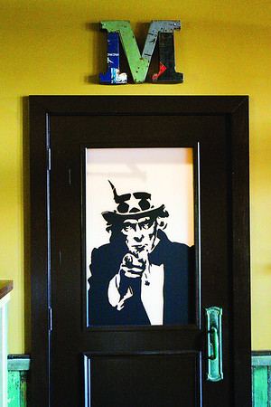 An image of Uncle Sam is displayed on the door to the men's restroom at The Exchange pub + kitchen in New Albany. Staff photo by Christopher Fryer