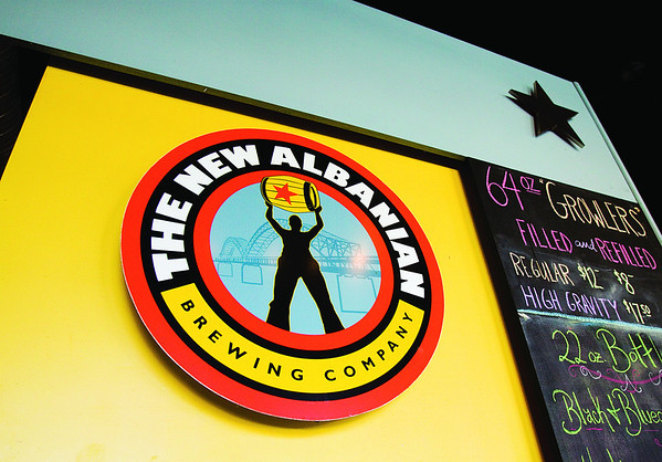 A logo for the New Albanian Brewing Company hangs above the bar at the Bank Street Brewhouse in New Albany. Staff photo by Christopher Fryer