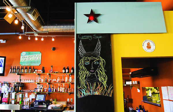 A drawing by Louisville artist Bridget Filburn hangs next to the bar at the Bank Street Brewhouse in New Albany. Staff photo by Christopher Fryer