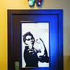 An image of Rosie the Riveter is displayed on the door to the women's restroom at The Exchange pub + kitchen in New Albany. Staff photo by Christopher Fryer
