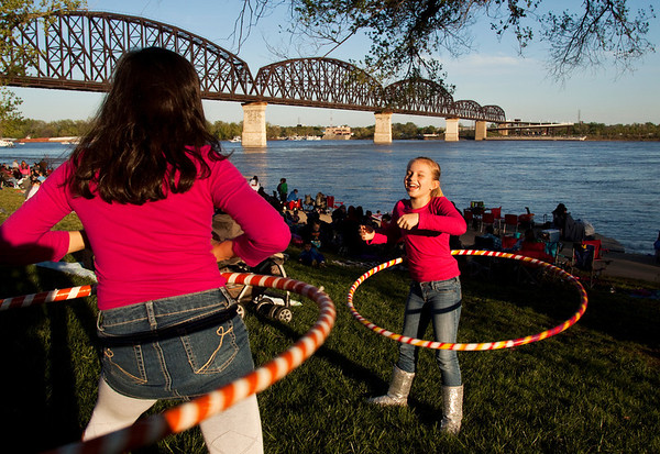 Irena Wolfrom, left, and Isabella Murphy, both of Richmond, Ky., have a hula hooping contest at Van Dyke Park in Jeffersonville while waiting for the fireworks to start during Thunder Over Louisville on Saturday evening. Staff photo by Christopher Fryer