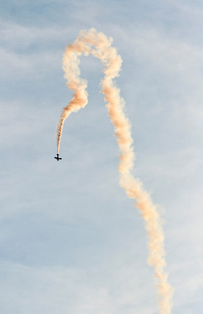 A biplane performs stunts above the Ohio River during the air show at Thunder Over Louisville on Saturday. Staff photo by Christopher Fryer