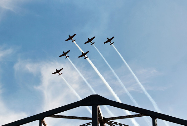 Aircraft fly above the Ohio River during the air show at Thunder Over Louisville on Saturday afternoon. Staff photo by Christopher Fryer
