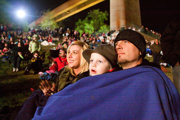 From left, Karissa, Chase and James Jaques, of Jeffersonville, look on from Van Dyke Park in Jeffersonville as fireworks explode above the Ohio River during Thunder Over Louisville on Saturday evening. Staff photo by Christopher Fryer