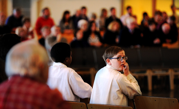 Altar server Dylan Payne awaits his queue  during Ash Wednesday's Mass at Sacred Heart in Jeffersonville.<br /> Staff photo by Tyler Stewart
