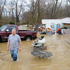 "Tony Gore, Sellersburg, wades through his backyard after overflow from Muddy Fork Creek flooded his property just off St. Joe Road. ""[I] wasn't really ready for this one,"" said Gore, who has dealt with flooding before. <br /> Staff photo by Tyler Stewart"