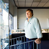 Jim Benton, Jeffersonville, looks out the front window of the jewelry store he owns with his sister, Benton Fine Jewelry, along West Court Avenue in Jeffersonville. Benton fears that the Ohio River Bridges Project tolls will keep Louisville clients from coming to their location, and has considered starting a delivery service to cater to those customers. Staff photo by Christopher Fryer
