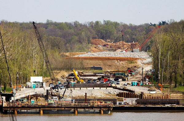 Crews work along the Kentucky river bank at the east-end crossing of the Ohio River Bridges Project earlier this month. Staff photo by Christopher Fryer