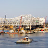 A barge moves across the Ohio River as crews work on the downtown crossing of the Ohio River Bridges Project in late March. Staff photo by Christopher Fryer
