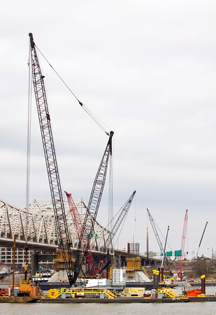 Cranes rise above the Ohio River as crews work on the downtown crossing of the Ohio River Bridges Project in late March. Staff photo by Christopher Fryer