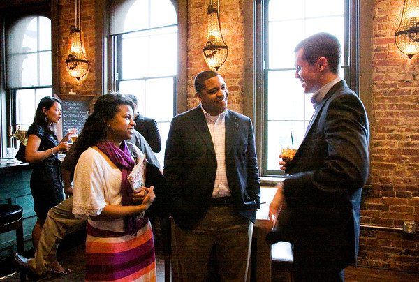 Attendees hang out during the launch party for the young professionals issue of Southern Indiana Business Source at The Exchange Pub + Kitchen in New Albany on Monday evening. Staff photo by Christopher Fryer