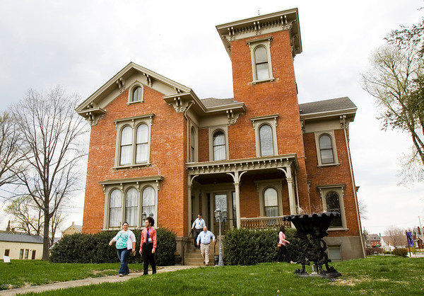 Conference attendees make their way back to a shuttle after touring the St. Paul's Episcopal Church Parish House as part of the Preserving Historic Places: Indiana's Statewide Preservation Conference in New Albany on Friday afternoon. Staff photo by Christopher Fryer