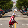 A pedestrian crosses Spring Street in downtown Jeffersonville on Friday afternoon. Staff photo Christopher Fryer