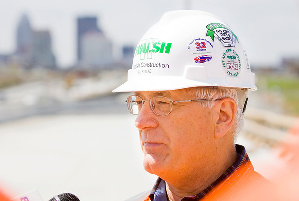 Max Rowland, communications project manager with Walsh Construction, takes questions from members of the media on a temporary bridge along Interstate 71 during a tour of the Ohio River Bridges Project as part of National Work Zone Awareness Week in Louisville on Wednesday afternoon. Staff photo by Christopher Fryer