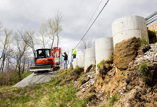 A city crew uses an excavator to work on a preventative maintenance project along Spring Street Hill Road in New Albany on Tuesday afternoon. Staff photo by Christopher Fryer