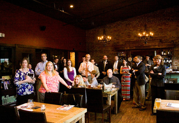 Attendees look on as Southern Indiana Business Source Editor Daniel Suddeath, New Albany, speaks during the launch party for the young professionals issue at The Exchange Pub + Kitchen in New Albany on Monday evening. Staff photo by Christopher Fryer