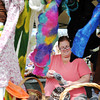 Annette Robinson, Jeffersonville, browses through socks and scarves at the Alpaca Joy Boutique during the Indiana Fiber and Music Festival at the Tri-County Shrine Club on Saturday. <br /> Staff photo by Tyler Stewart