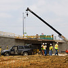 Crews work on a section of the Ohio River Bridges Project along Indiana Avenue between Fifth and Sixth streets in Jeffersonville on Friday afternoon. Staff photo by Christopher Fryer