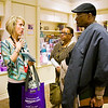 Teresa Secor, Sellersburg, left, gives lung cancer patient Carter Martin and his wife Dee, both of Louisville, a tour of the M. Krista Loyd Resource Center during her volunteer shift at the James Graham Brown Cancer Center in downtown Louisville. Secor is a lung cancer survivor and volunteers at the center on Wednesdays. Staff photo by Christopher Fryer