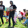 Left to Right: Dancers Reese Thomas and Antic Young teach the kids the cupid shuffle at the Purdue Extension's Spring festival Saturday morning. <br /> Staff photo by Tyler Stewart