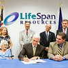 State Rep. Ed Clere, R-New Albany, seated at right, looks on as Gov. Mike Pence, center, ceremonially signs House Enrolled Act 1391 at LifeSpan Resources in the Floyd County Branch of the YMCA on Wednesday afternoon. Rep. Clere authored the bill, which is designed to provide senior citizens with more home care services. Staff photo by Christopher Fryer