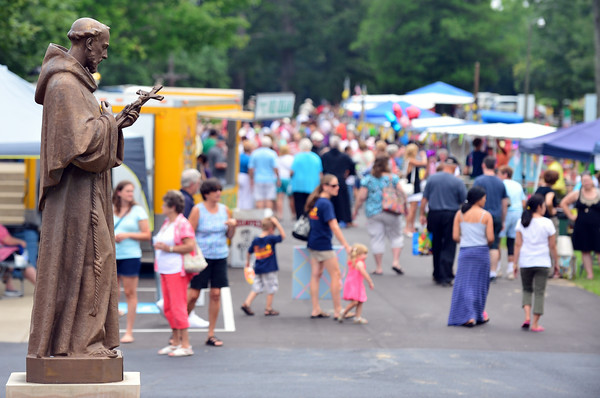 Attendees of the annual Mount Saint Francis Center for Spirituality Picnic walk along the booth filled road Saturday morning. The picnic provides community outreach for the friars and supports the various programs offered through Mount Saint Francis. <br /> Staff photo by Tyler Stewart