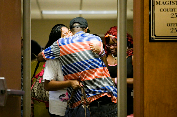 Marie Clark, New Albany, and Frederick Whitaker, Chicago, embrace following the sentencing hearing for Cody Cashion at the City-County Building in downtown New Albany on Monday morning. Clark is the grandmother and Whitaker is the father of Tai'zah Hughes, one of three siblings that were killed after Cashion fired a flare into a New Albany home in January of this year. Staff photo by Christopher Fryer