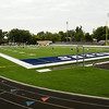 The Providence football team practices on the new artificial playing surface on Gene Sartini Field at Providence High School's Murphy Stadium in Clarksville on Wednesday evening. Providence, New Albany and Floyd Central high schools all had artificial turf installed this summer. Staff photo by Christopher Fryer