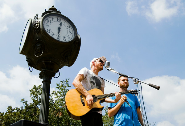 "Singer-songwriter Preston Pugmire, Rexberg, Idaho, left, performs a duet of his song ""Headphones"" with Indiana University Southeast senior Matt McKechnie, Clarksville, during Week of Welcome festivities in McCullough Plaza at IUS in New Albany. Staff photo by Christopher Fryer"