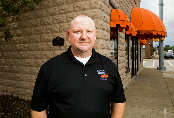 """Harvest Homecoming Festival President Jeff Cummins, New Albany, is pictured outside of the festival's headquarters in downtown New Albany. This is the 47th year for the annual festival, and this year's theme is """"Harvest of Honor"""". Staff photo by Christopher Fryer"""