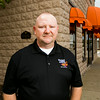 "Harvest Homecoming Festival President Jeff Cummins, New Albany, is pictured outside of the festival's headquarters in downtown New Albany. This is the 47th year for the annual festival, and this year's theme is ""Harvest of Honor"". Staff photo by Christopher Fryer"