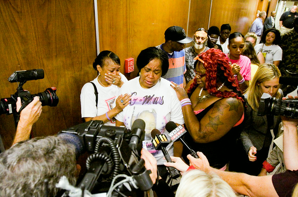 Theresa Hughes, center right, consoles her mother, Marie Clark, center, both of New Albany, as they speak to members of the media following the sentencing hearing for Cody Cashion at the City-County Building in downtown New Albany on Monday morning. Cashion fired a flare into a New Albany home in January of this year that started a fire and killed three of Hughes' children. Staff photo by Christopher Fryer