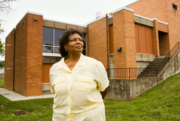 Marcia Booker, New Albany, stands outside of the William O. Vance Center along Dennison Avenue in New Albany on Tuesday afternoon. Booker is the activities director for the New Albany Housing Authority, and the president of the Community Women for Unity and Equality. Staff photo by Christopher Fryer