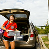 Freshman Riley Kaiser, 18, New Albany, unloads her belongings while moving into Orchard Lodge at Indiana University Southeast on Thursday morning in New Albany. Kaiser, a secondary education major, is one of 399 students scheduled to live in the school's on-campus residence halls. Staff photo by Christopher Fryer