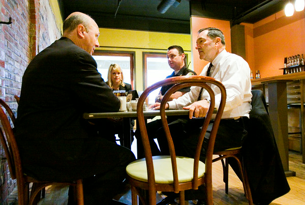 Indiana Sen. Joe Donnelly, right, speaks with New Albany Mayor Jeff Gahan at Toast on Market while having breakfast with local officials in downtown New Albany on Thursday morning as part of his Ohio River counties tour. Staff photo by Christopher Fryer