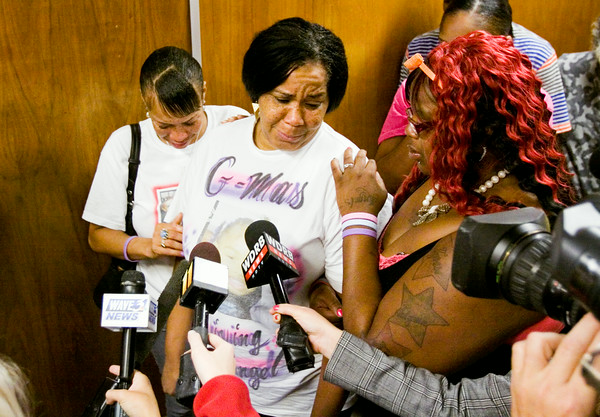 Theresa Hughes, right, consoles her mother, Marie Clark, center, both of New Albany, as they speak to members of the media following the sentencing hearing for Cody Cashion at the City-County Building in downtown New Albany on Monday morning. Cashion fired a flare into a New Albany home in January of this year that started a fire and killed three of Hughes' children. Staff photo by Christopher Fryer