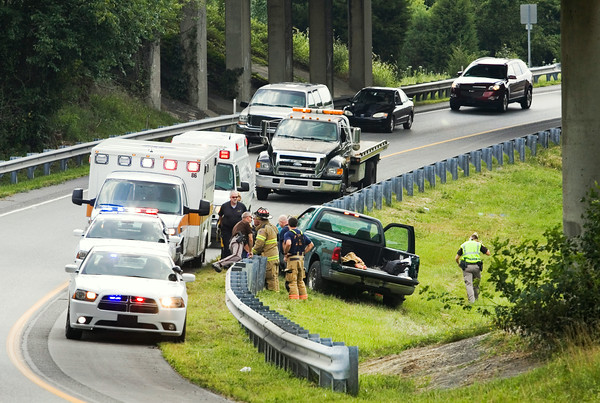 Emergency crews work the scene of an accident that occurred at about 2:50 p.m. at the interchange of interstates 64 and 265 in Floyd County on Tuesday. Staff photo by Christopher Fryer