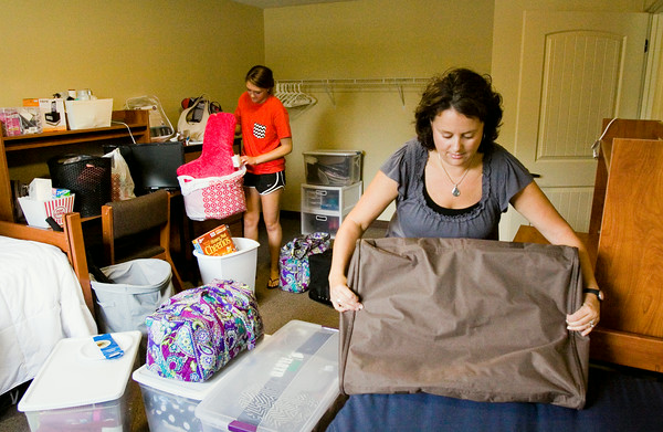 Shannon Kaiser, New Albany, right, helps her stepdaughter, Riley, 18, move into Orchard Lodge at Indiana University Southeast on Thursday morning in New Albany. Riley, an incoming freshman majoring in secondary education, is one of 399 students scheduled to live in the school's on-campus residence halls. Staff photo by Christopher Fryer