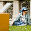 "Janice Molnar, Jeffersonville, listens and harmonizes with music generated by solar-powered sound boxes as part of the installation ""Sun Boxes"" on the front lawn of the Carnegie Center for Art and History in downtown New Albany on Friday afternoon. The piece was created by sound artist Craig Colorusso, Rogers, Ark., and each box is activated and powered by direct sunlight, and each one generates a single note that Colorusso originally recorded with an electric guitar. Once all the boxes are active they form a B flat six chord, which contains four notes. Five boxes are committed to each of the four notes, with 20 boxes total in the installation. Colorusso has taken the portable installation to 19 states since 2009, and plans to make stops in all 50. Staff photo by Christopher Fryer"