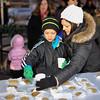 Children enjoy milk and cookies before Light Up Sellersburg on Friday. Photo by Joe Ullrich