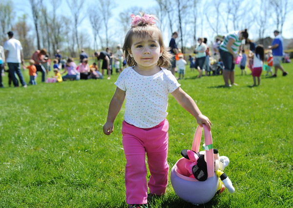 One-year-old Addison Rough walks through the outfield as she looks for eggs during the Jeffersonville Parks Department's Helicopter Easter Egg Drop Saturday morning at Vissing Park. <br /> Staff photo by Tyler Stewart
